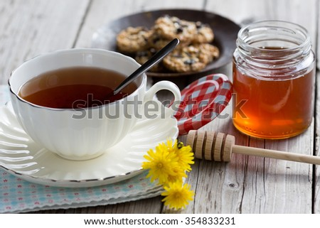 Cup of hot tea with delicious cookies selected - stock photo