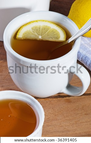 Cup of hot tea with lemon and honey