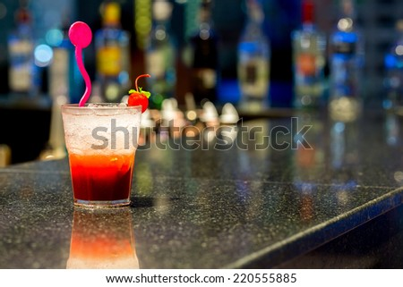 cup of Iced Cocktail with bar background - stock photo