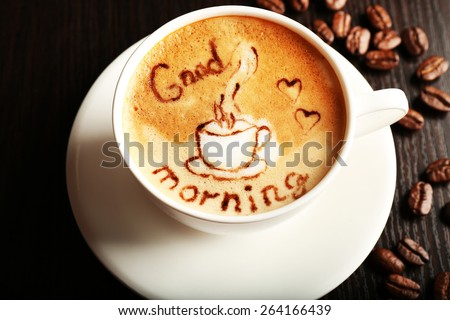 Cup of latte art coffee with grains, closeup - stock photo