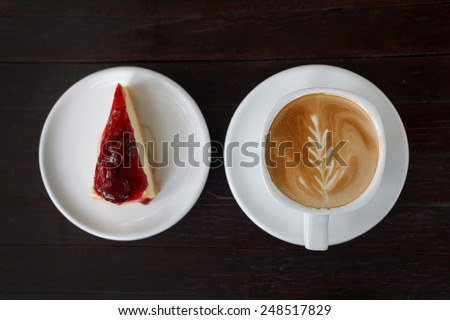 Cup of latte coffee with strawberry Cheesecake  - stock photo