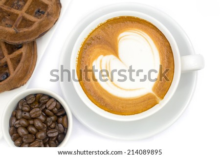 Cup of latte coffee with waffer cake with love heart shape pattern  - stock photo