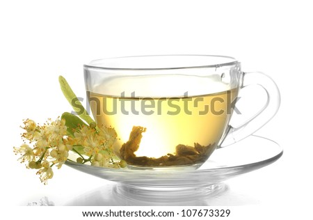 cup of linden tea and flowers isolated on white - stock photo
