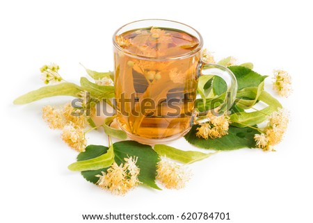 Cup of linden tea and flowers isolated on white background