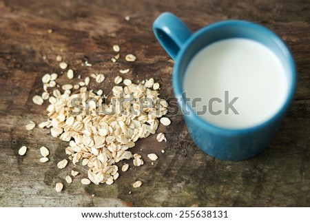 Cup of milk on the wooden table - stock photo
