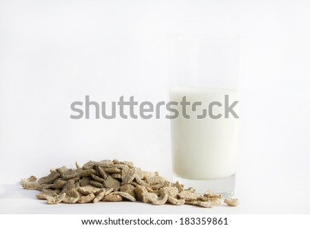 Cup of milk with corn flakes, nutrition concept - stock photo