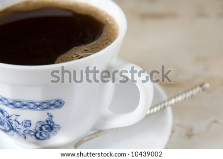 Cup of morning black coffee - stock photo
