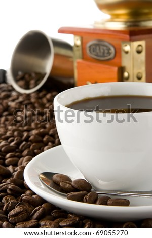 cup of of coffee, grinder and beans on isolated white background - stock photo