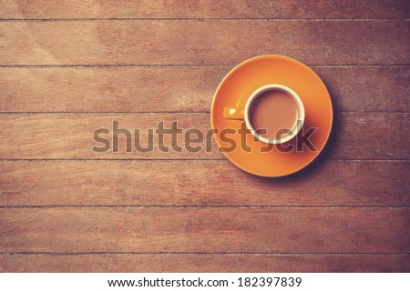 Cup of offee on a wooden table. - stock photo