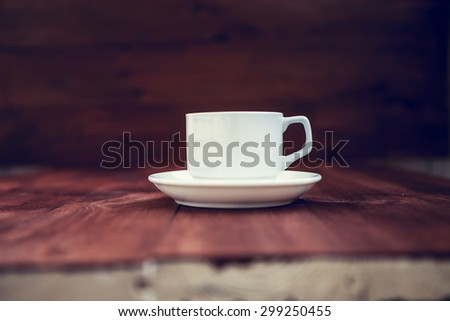 Cup of ?offee on a wooden table - stock photo