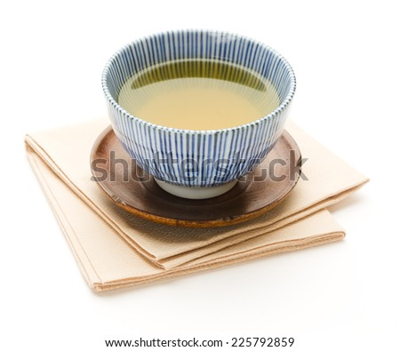 Cup of simmered green tea as a symbol of traditional Japanese hospitality - stock photo