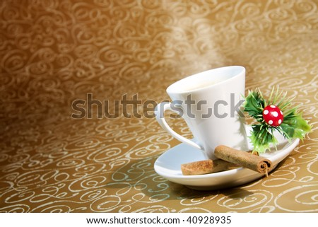 cup of steaming coffee with Christmas motifs on deep golden brown - stock photo