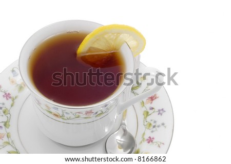 Cup of steeped tea served with lemon on white background.