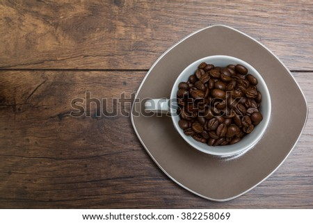 Cup of strong coffee on a wooden table