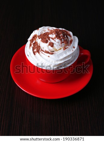 Cup of strong coffee on color wooden background - stock photo