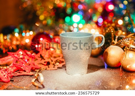 Cup of tasty hot cocoa, on wooden table,  on shiny background - stock photo