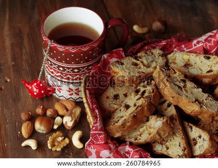 Cup of tea and Biscotti, cookies with nuts, dried fruits - stock photo