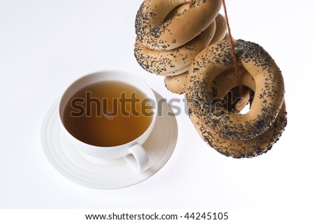 cup of tea and bunch of traditional poppy seed bagels - stock photo