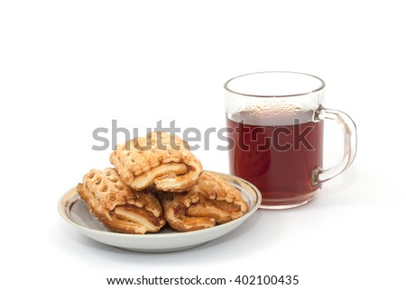 cup of tea and cake on a saucer on a white background