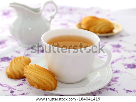 cup of tea and cookies - stock photo