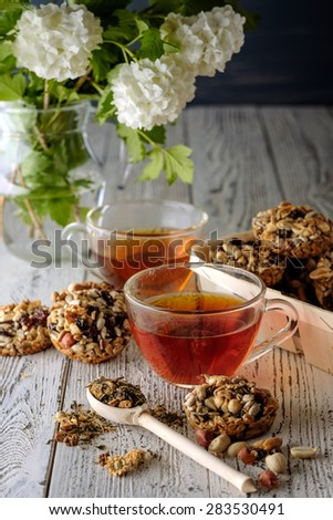 Cup of tea and cookies made of nuts and raisins. Kozinaki.