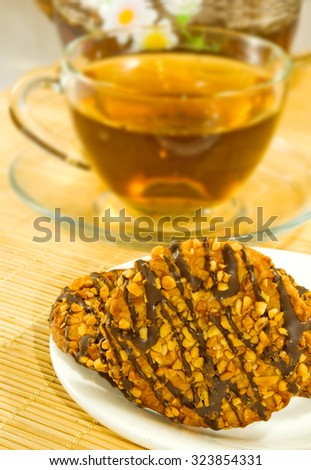 cup of tea and cookies on the table