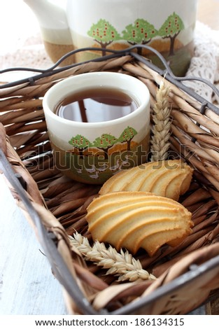 cup of tea and cookies  on wooden  - stock photo