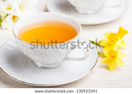 Cup of tea and daffodil