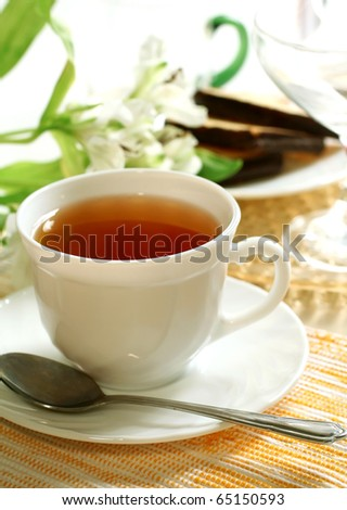 cup of tea and flowers - stock photo