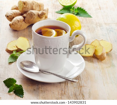 Cup of tea  and ginger. Selective focus - stock photo
