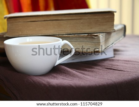 cup of tea and old books