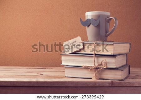 Cup of tea and old books for Father's Day celebration - stock photo