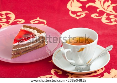 cup of tea and piece of cake - stock photo