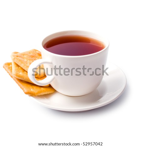 cup of tea and some cookies on white background - stock photo