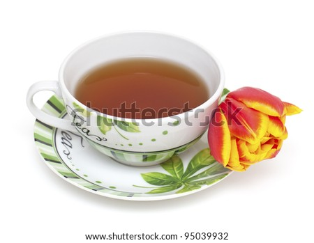 cup of tea and tulip flower isolated on white - stock photo