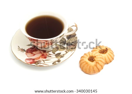 cup of tea and two cookies on white background closeup - stock photo