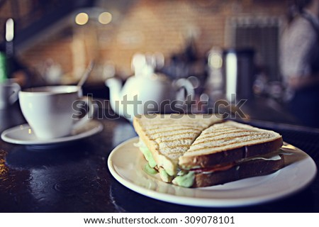 cup of tea at a cafe blurred background - stock photo