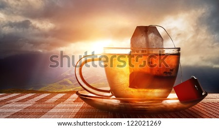 cup of tea at sunset - stock photo
