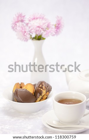 cup of tea, cake on a white background in high key