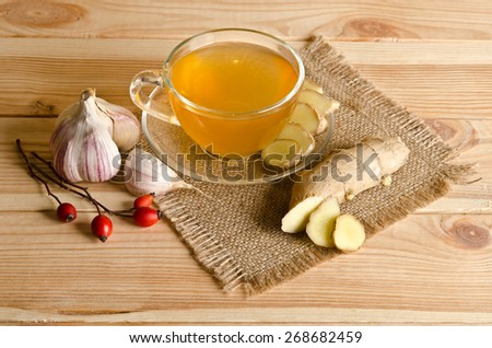 Cup of tea , ginger, garlic. Home antimicrobial therapy - stock photo