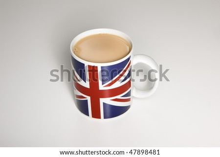 Cup of tea in an union jack mug - stock photo