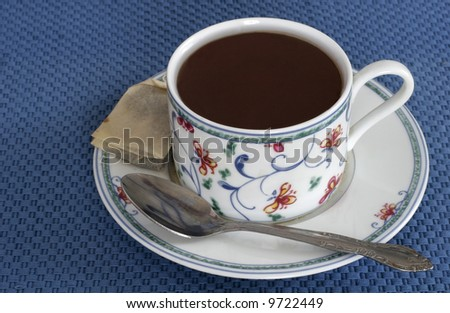 cup of tea in decorative cup with spoon