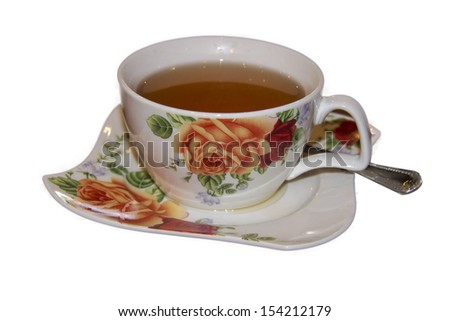 Cup  of tea in rose patterned cup and saucer isolated on white background