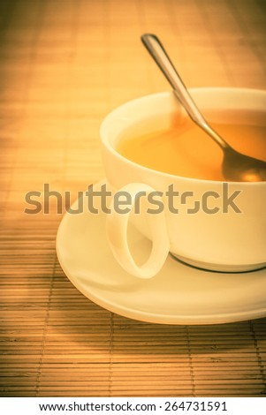 cup of tea on a bamboo mat - stock photo