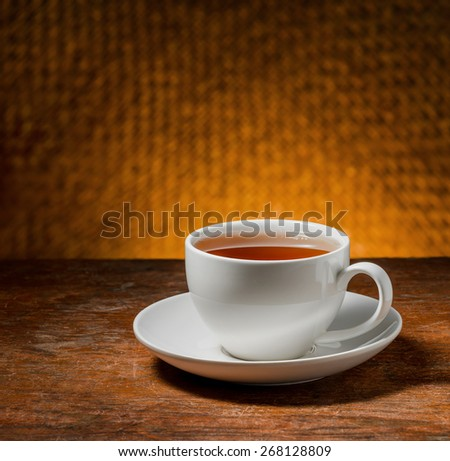 cup of tea on a wooden table
