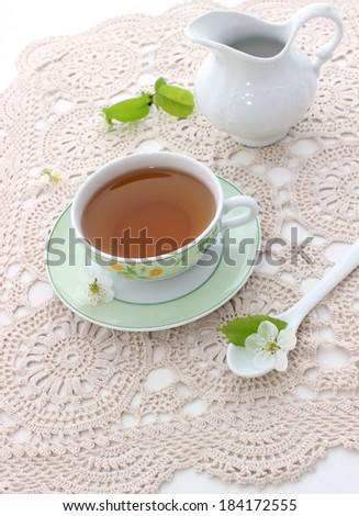 cup of tea on beautiful napkin - stock photo