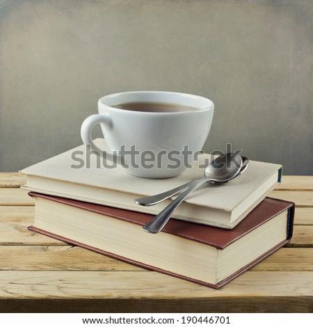 Cup of tea on vintage books - stock photo