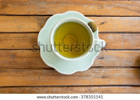 cup of tea on vintage wooden background.