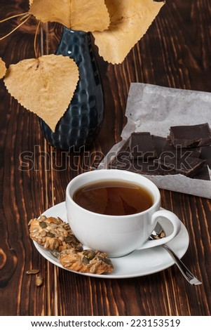Cup Of Tea Or Coffee. Dark Chocolate. Cookies With Seeds. Wooden Background.