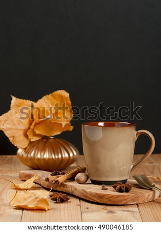Cup Of Tea Or Coffee. Spices. Olive Tree Board. Wooden Table. Autumn Leaves